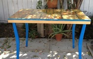 "<p style=""text-align: center;""><strong>Small Table with Blue Legs</strong></p>"