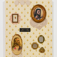 """<p style=""""text-align: center;"""">Genevieve Gaignard<br /><em>W.W.J.D.</em>, 2017<br />Vintage wallpaper, found framed images, pins, doilies, original drinking fountain sign, found mirrors, rosary, and porcelain figurine<br />52.5 x 36 inches</p>"""