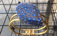 <p>painted wood and resin cuff&nbsp; $55</p>