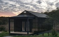 <p>4MX Greenhouse</p> <p>2018</p> <p>4M Malcom X Greenhouse is anarchitecturaland programmatic artwork built from an ideation of community holistic health. A greenhouse mimicking the shape of Malcolm X's birth house built on his birth site's foundation in Omaha, featuring spiritual/meditation programs, phytoremediation plant distribution and youth workshops focused on urban sustainability.</p> <p>4MX Greenhouse is positioned at a high architectural vantage point overlooking seventeen acres of native grassland.</p> <p>The Greenhouse project itself occurs across four related pillars of health, M1–M4.</p> <p>M-1 is the self-identifier and reflects a legacy of self-empowerment and determination through architecture. M-2 cleanses soil and air via phytoremediation plants and EPA-lead soil remediation. M-3 is Meditation put into practice with Perennialism-based programing featuring a zendo and salah prayer space overlooking the grasslands. M-4, the foundation, is medicinal food supply. This is the farm to table identity of the greenhouse edified by holistic health derived from vegetation grown on site. The EPA classifies the region a superfund site due to soil-borne industrial toxins including lead. Free phytoremediation plants from Ferns to Poplars will be available to residents wishing to leach toxins from their lands as well as direct EPA contacts for lead soil extraction around their homes, making it safe for self-reliant food production.</p> <p>Food crops will be free at local businesses such as the Fair Deal grocery store and restaurant. Omaha's Union for Contemporary Art, the Omaha Economic Development Corporation, and the Malcolm X Foundation of Omaha have already pledged ongoing support including a part-time gardener.4Mgives tools to empower participants to build resilience into their communities through direct utilitarian actions. Offering North Omaha residents the health benefits of nature while working collaboratively to rehabilitate their immediate environment