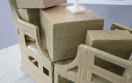 <p><em>Emotional Relocation</em></p> <p>Boxes filled with things and chairs facing eachother</p>