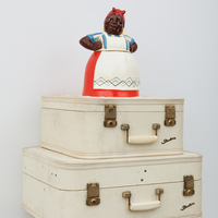 <p>Genevieve Gaignard<br /><em>White Guilt, 2020&nbsp;</em><br />Vintage suitcases, porcelain cookie jar, doily<br />29.5 x 21.5 x 18.25 inches&nbsp;</p>
